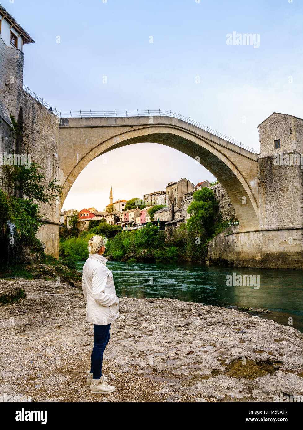 A woman looking at the famous Mostar Bridge in Mostar, Bosnia Stock Photo