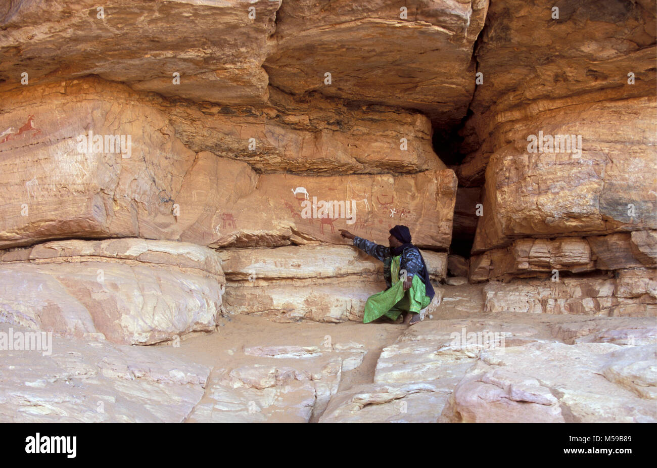 Libya. Ghat. Akakus National Park. Prehistoric rock art paintings. Rock-Art Sites of Tadrart Acacus. Tuareg man. - Stock Image