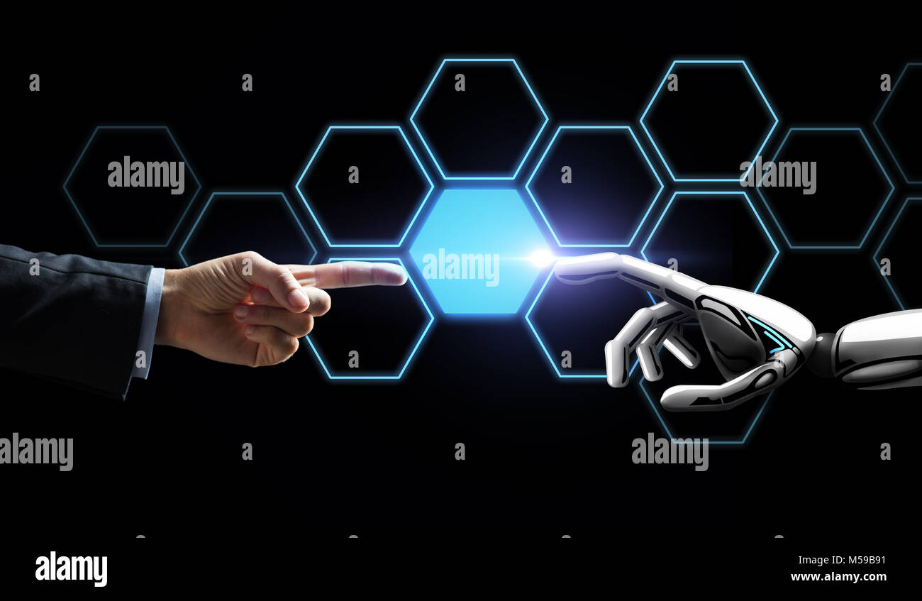 robot and human hand touching network hologram - Stock Image