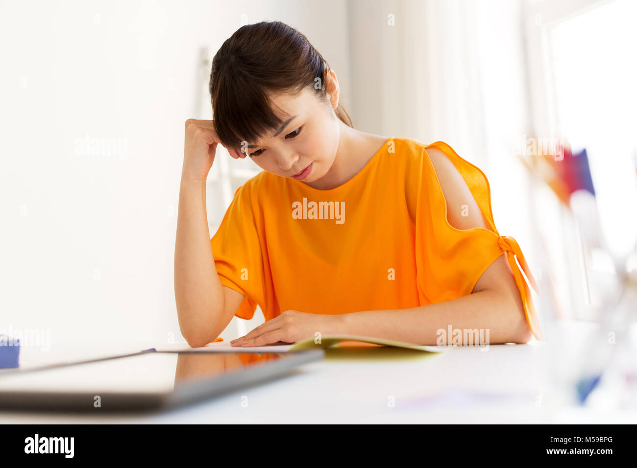 asian student girl with tablet pc learning at home - Stock Image
