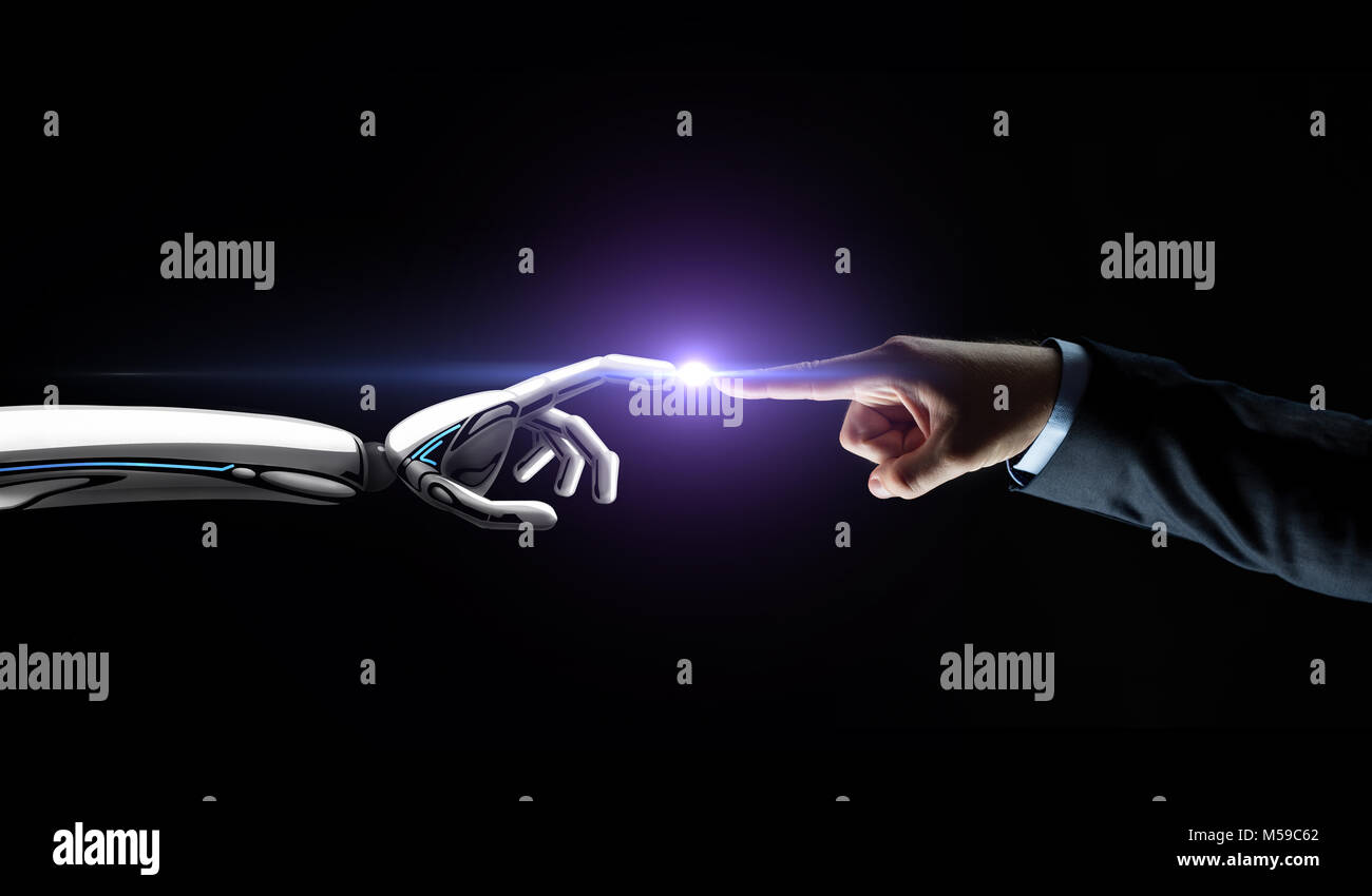 robot and human hand connecting fingers - Stock Image