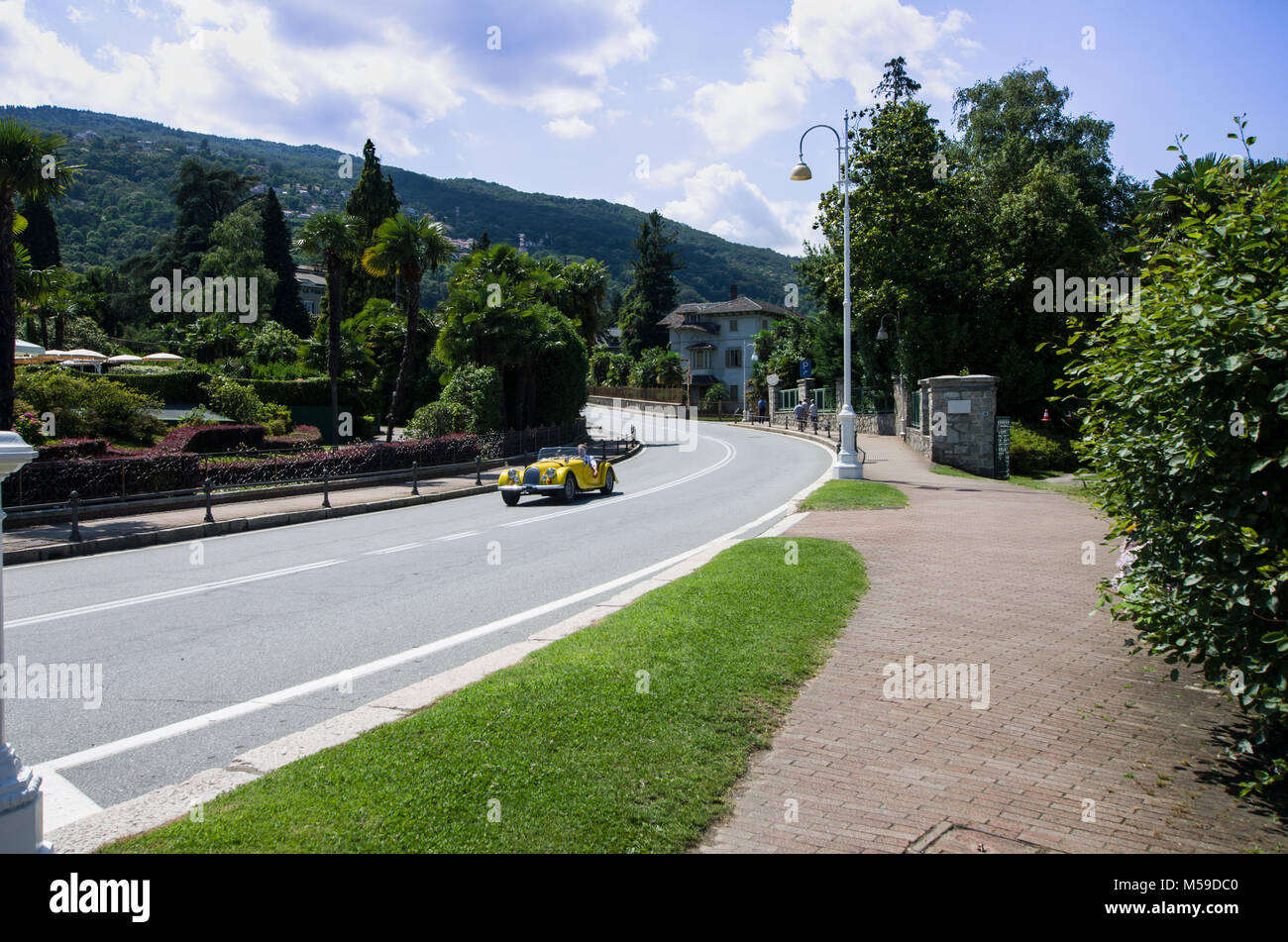 tourist traveling with his convertible car, on the roads of Lake Maggiore, Italy - Stock Image