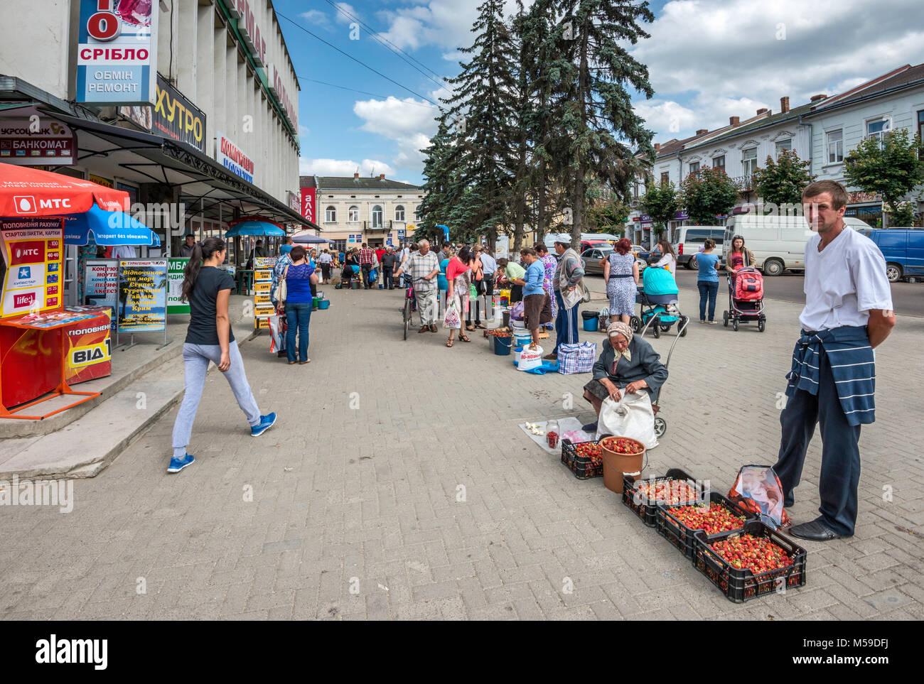 Street market at Taras Shevchenko Street in Kolomyia, Pokuttya, Prykarpattia region, Ivano-Frankivsk Oblast, Ukraine - Stock Image