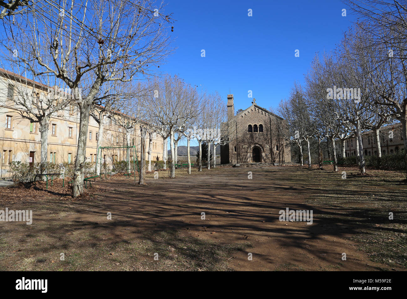 Spain, Catalonia, Puig-Reig. Can Vidal. Textile Industrial colony. 1901-1980. Church and housing hof the workers. - Stock Image