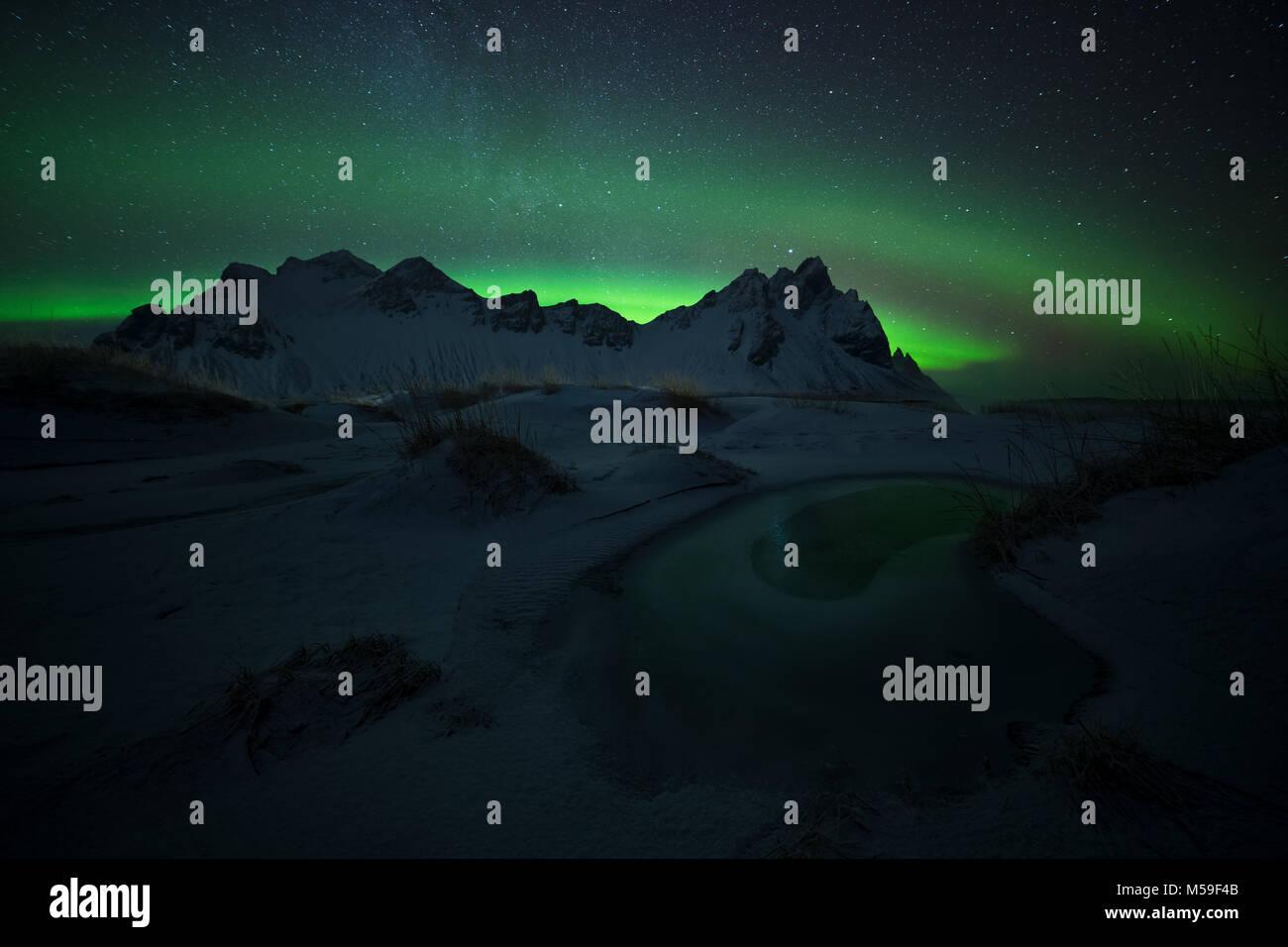 Green eye, aurora borealis at Stokksnes in Iceland - Stock Image