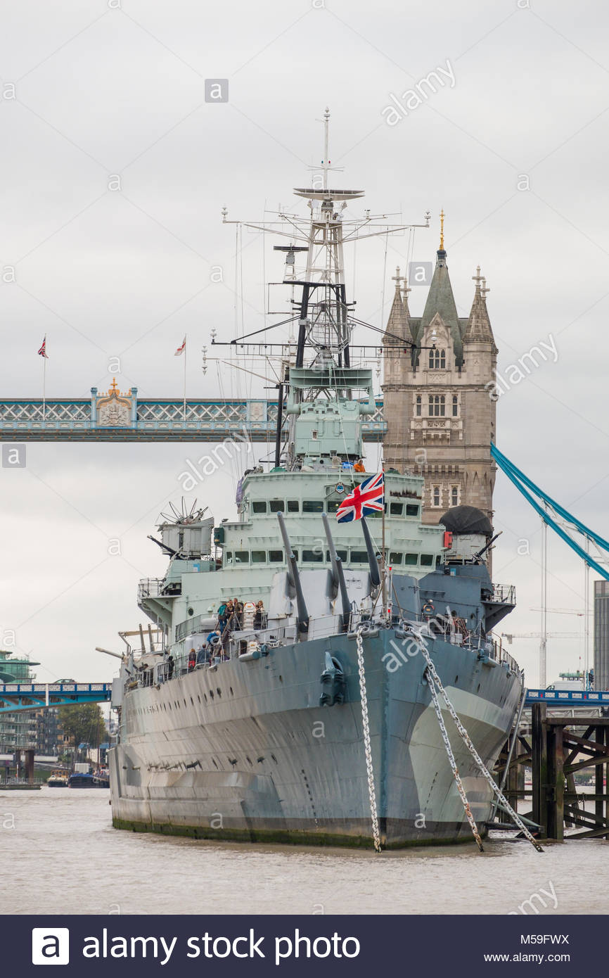 HMS Belfast Second World War Royal Navy warship at anchor in the River Thames with the Tower Bridge in the background, - Stock Image