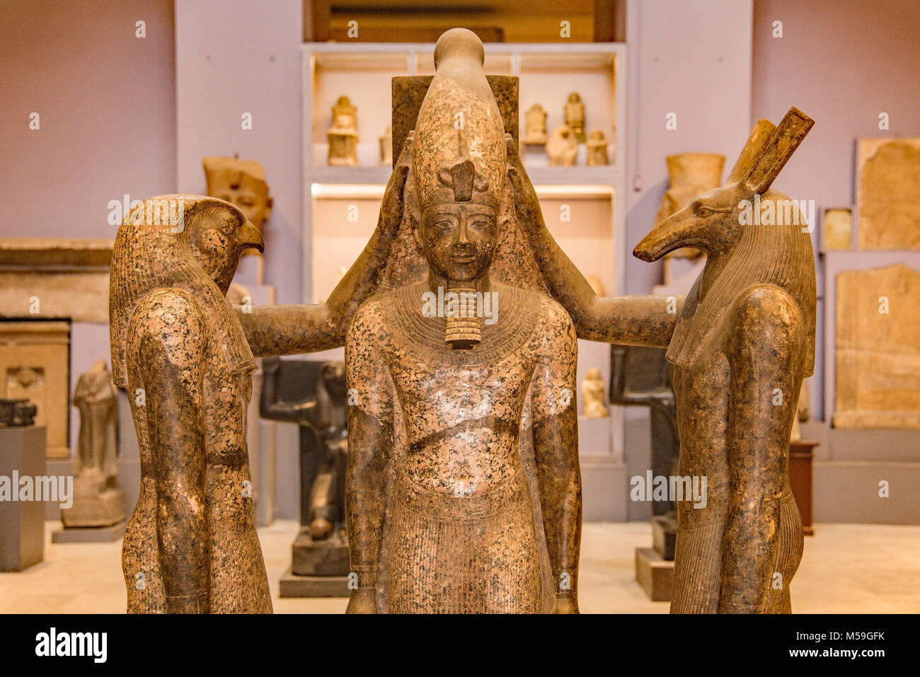 Ancient Egyptian Deities with pharaoh figure in the Cairo Museum of Antiquities, Egypt. - Stock Image