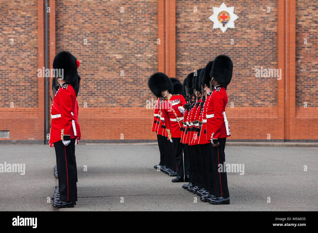 Windsor, UK. 21st February, 2018. An officer inspects the 1st Battalion Coldstream Guards as part of the Major General's Stock Photo