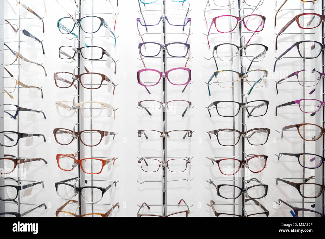 Rack with spectacle frames in an optician's shop - Stock Image