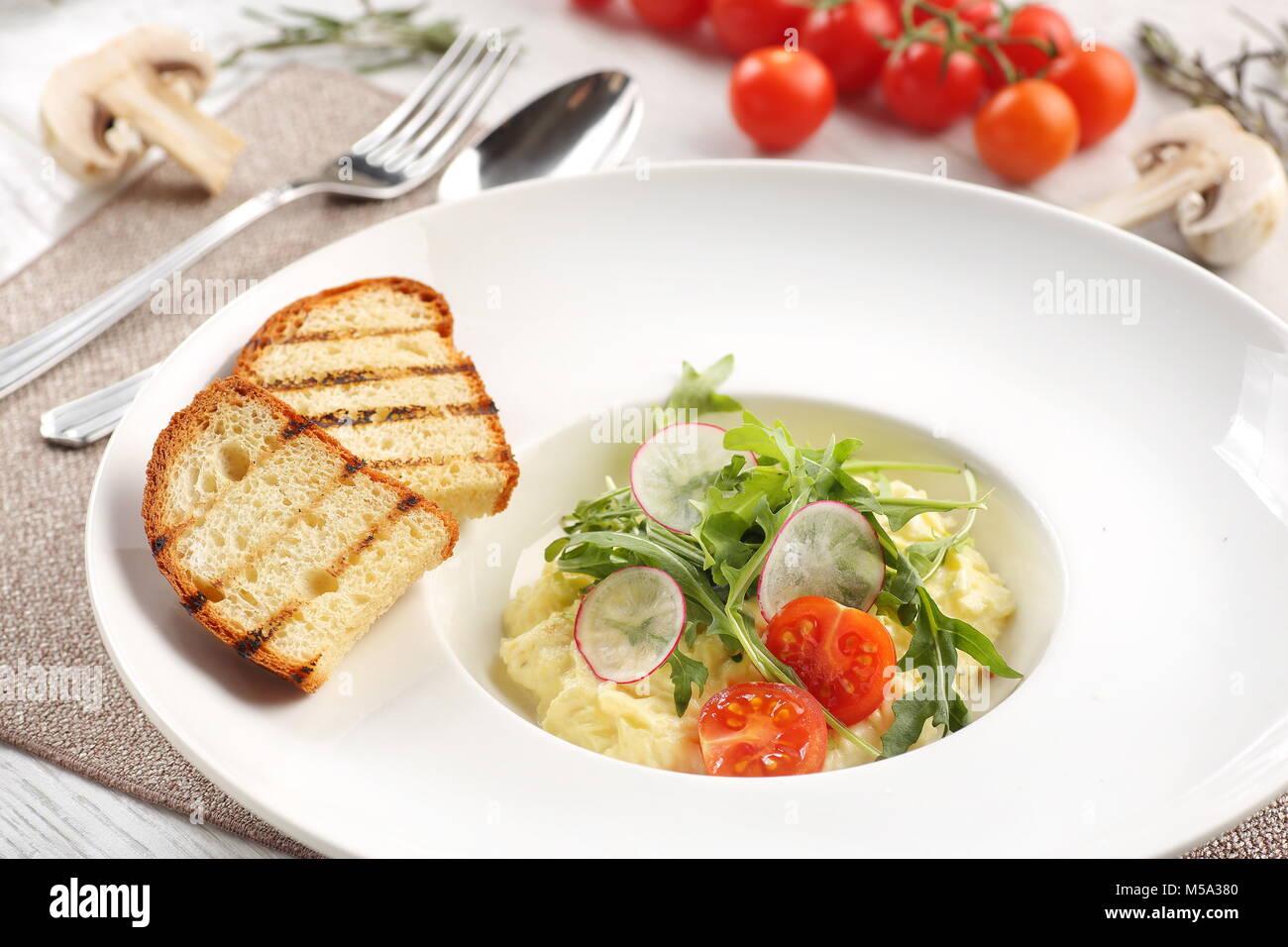 mashed potatoes on white wooden background - Stock Image