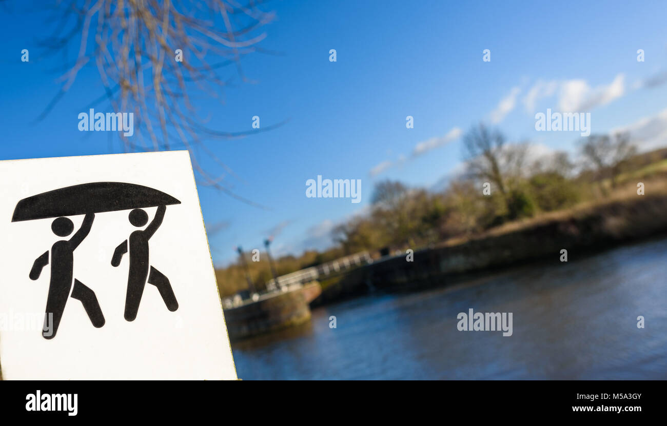 A portage sign for the canoe trail on the River Weaver at the Saltersford Lock, Northwich, Cheshire. The Weaver - Stock Image