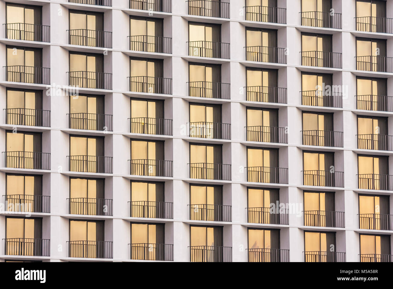Miami Hyatt Hotel symmetry balconies reflection uniformity high density dwelling sliding glass door - Stock Image