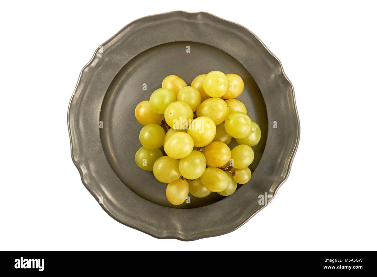 Bunch of green grapes on a metal plate, centrally, from above on a white background Stock Photo