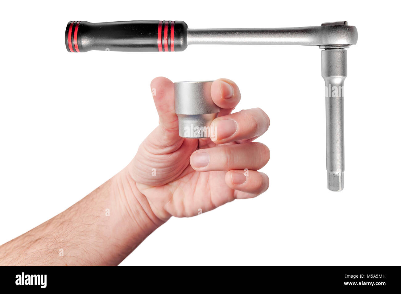 Hand holding replaceable head of automotive mechanic tool for maintenance and repair wrench - Stock Image
