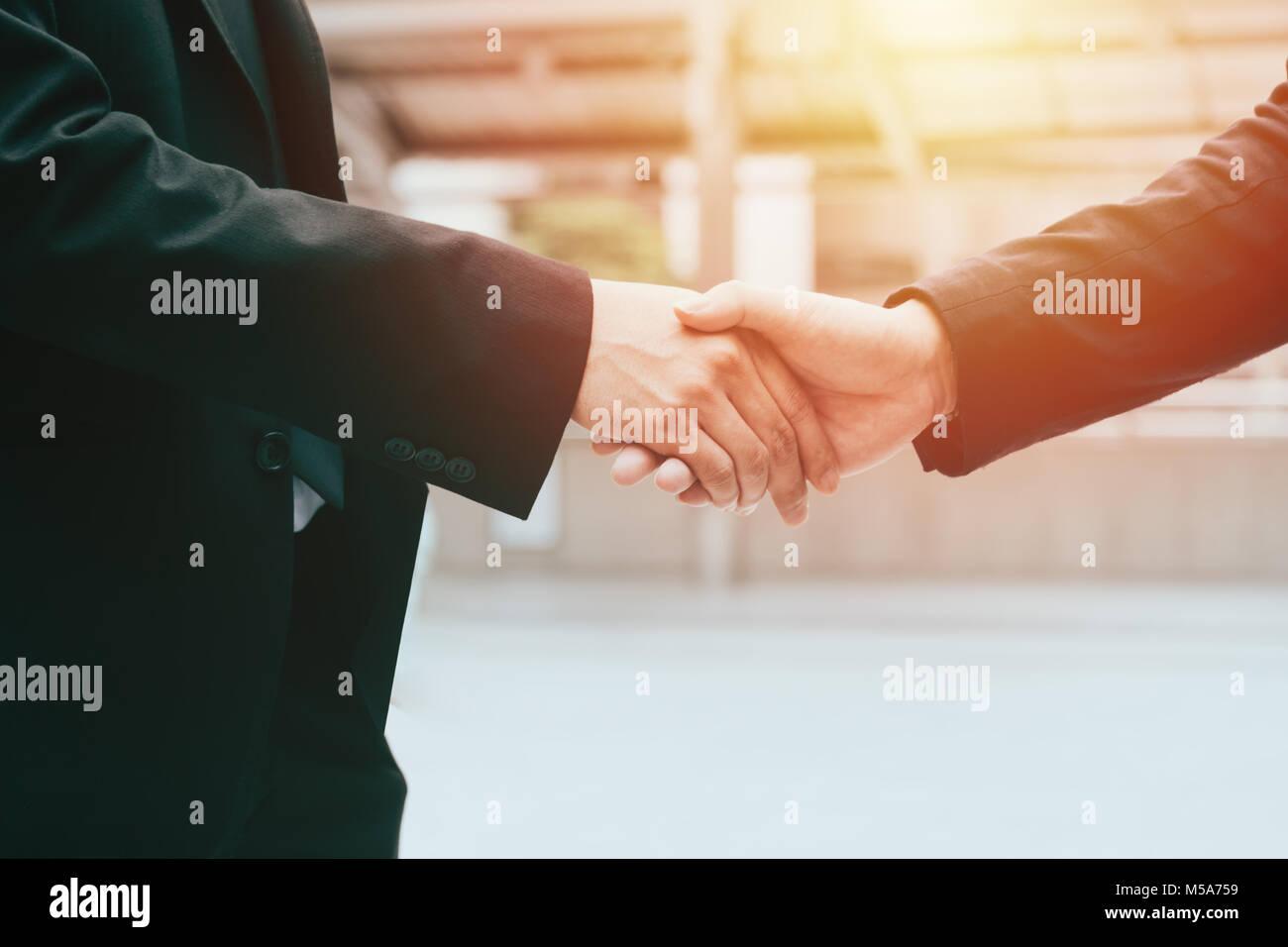 business man hand shaking closing a deal ,business team partnership concept - Stock Image