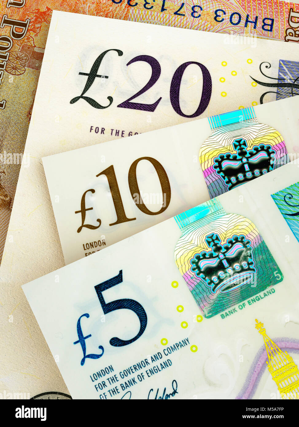 Sterling paper money - new issue £20 £10 and £5 pound notes close up - Stock Image