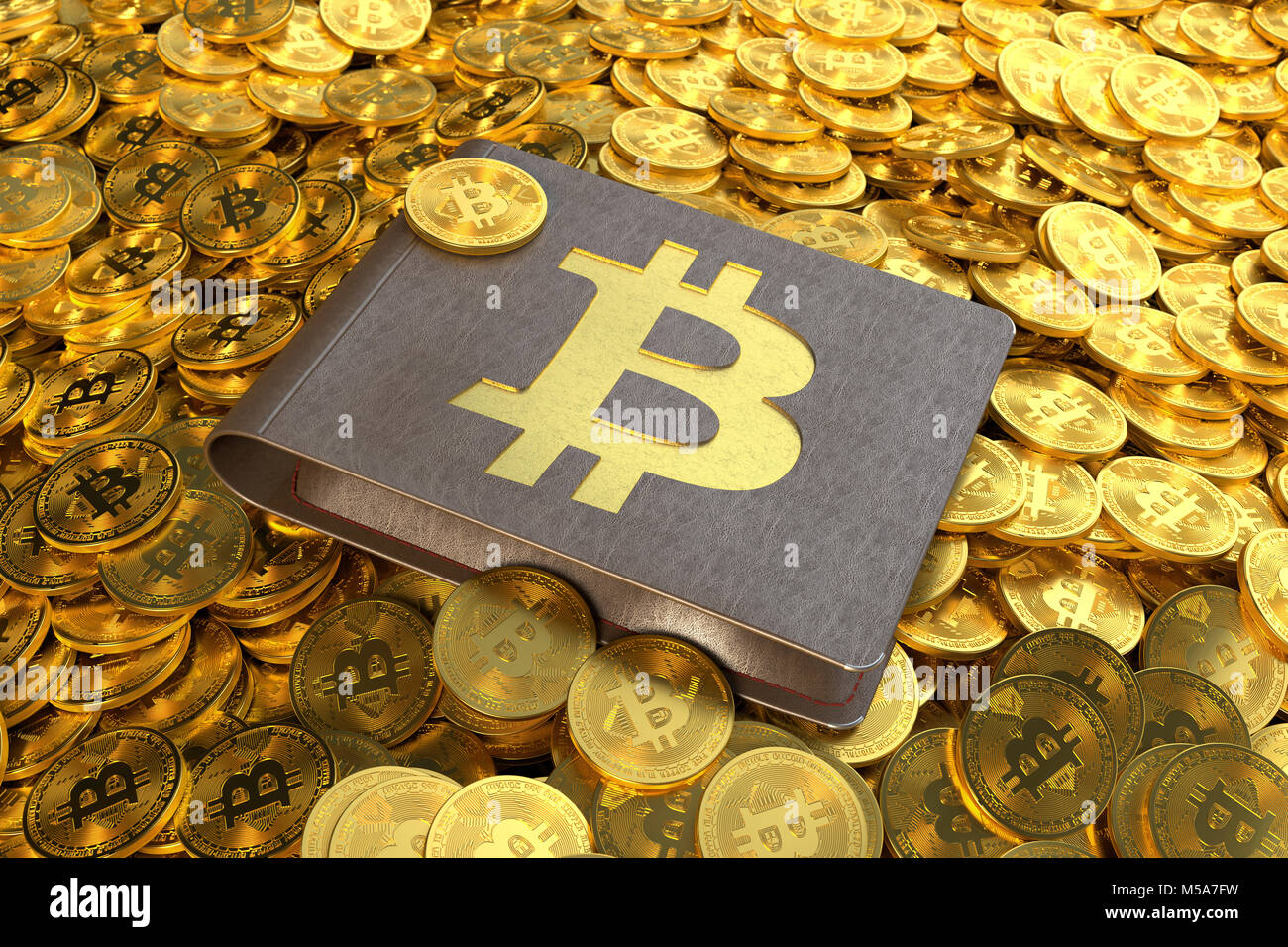 Bitcoin wallet holding Bitcoin cryptocurrency coins lying on a pile of Bitcoins - Stock Image