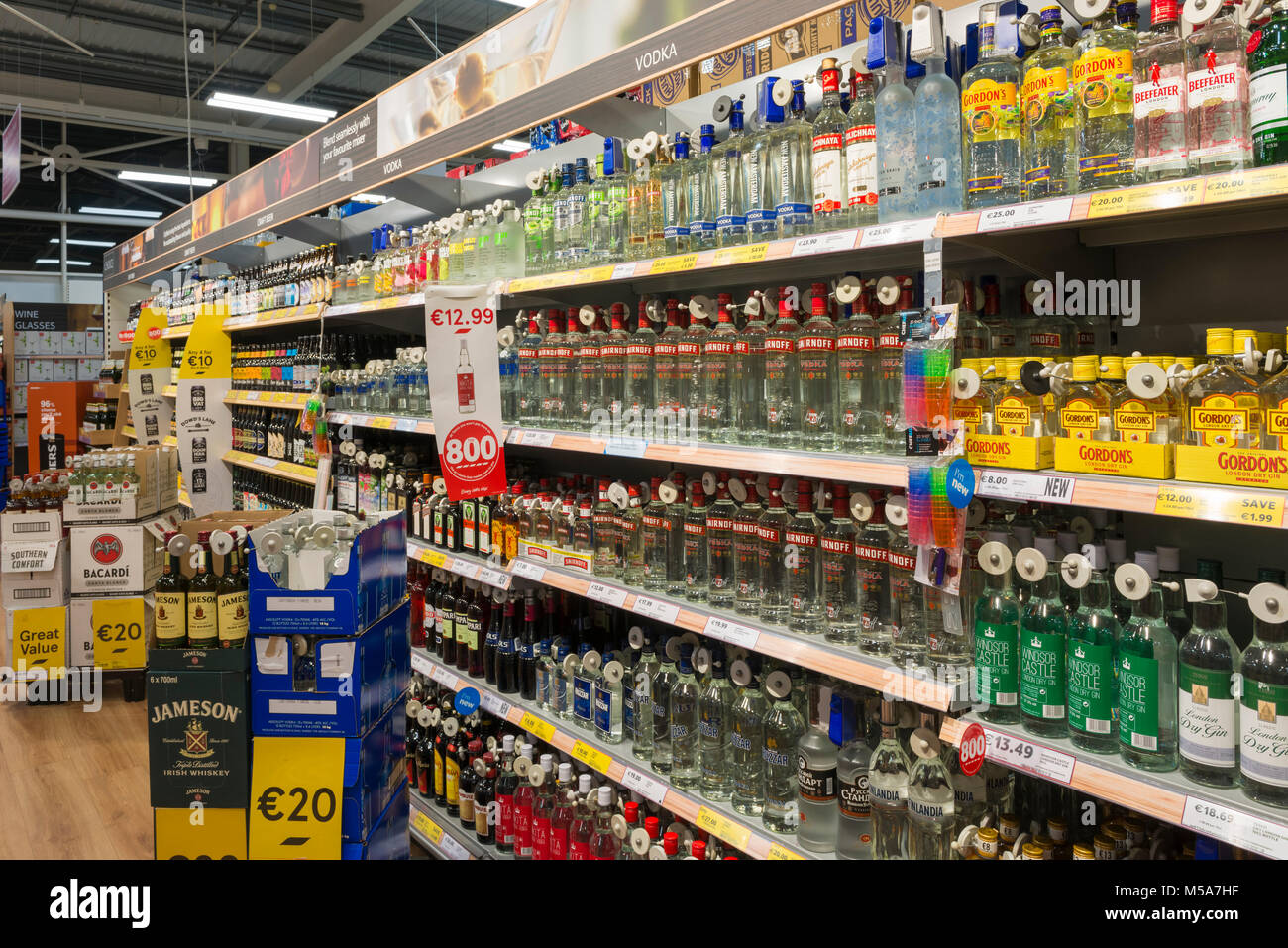 Alcohol spirits bottles on sale on a supermarket shelf, Ireland - Stock Image