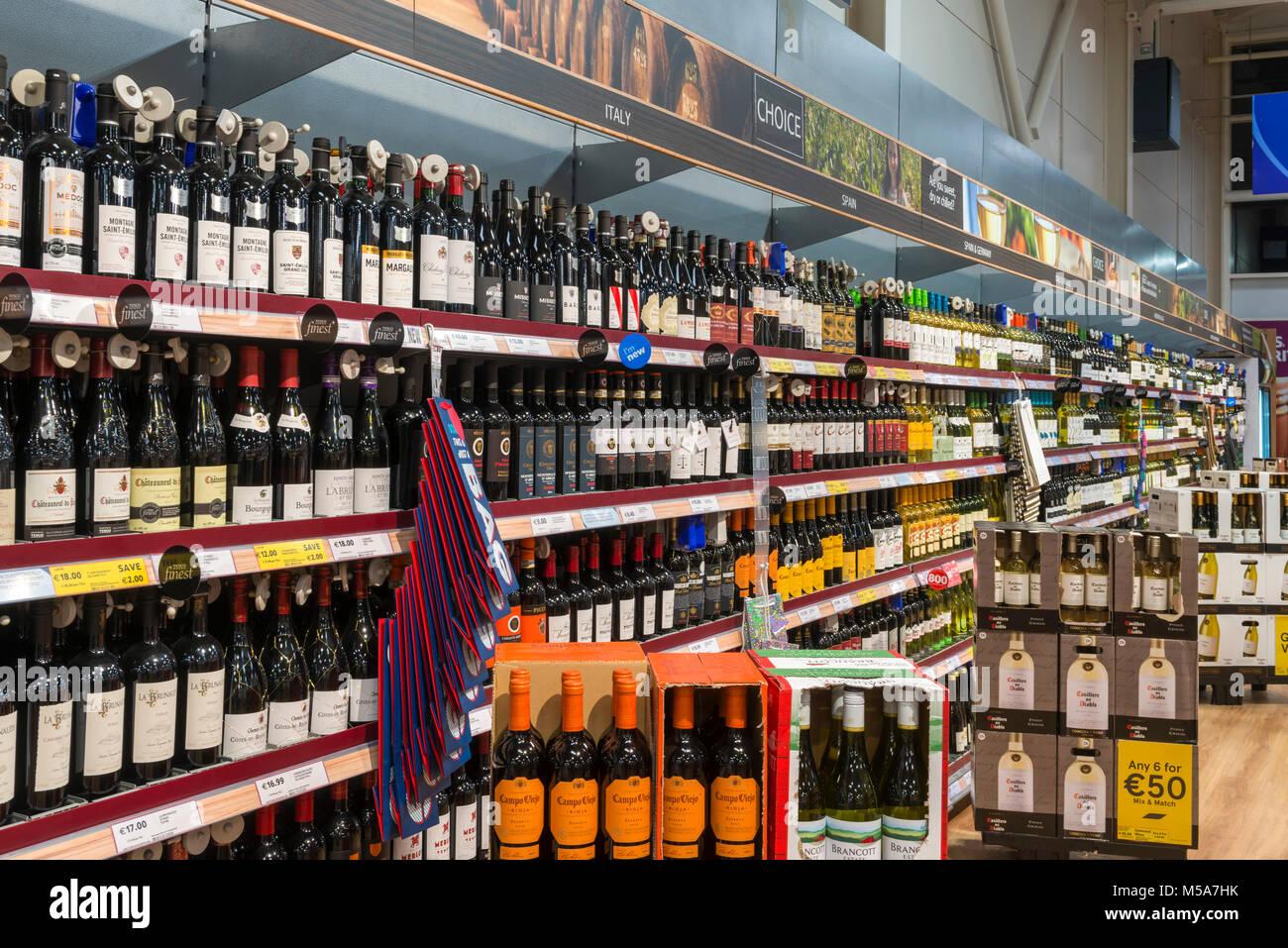 Wine bottles on a supermarket shelf, Ireland - Stock Image