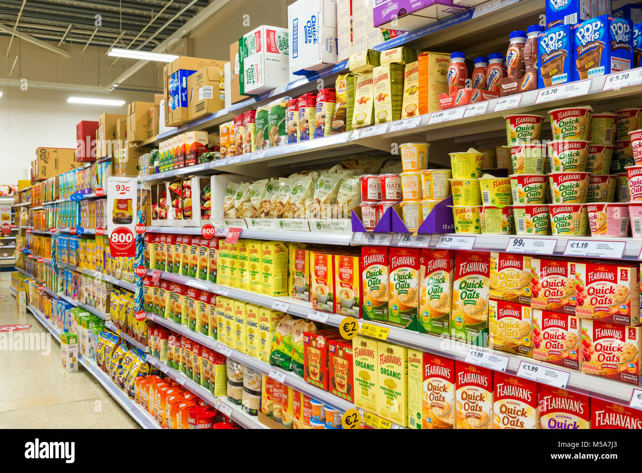 Breakfast cereals and snacks on display in a supermarket - Stock Image