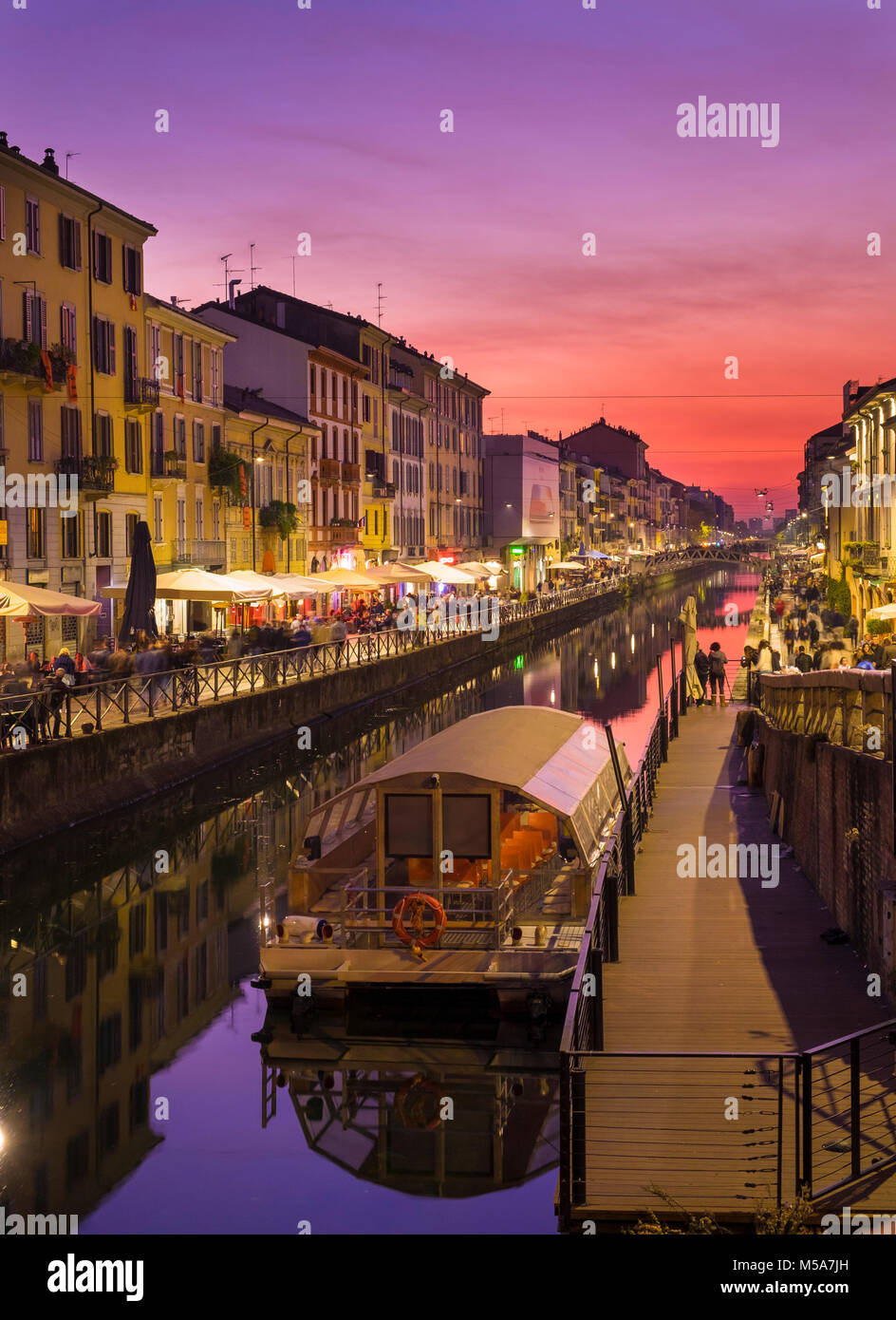 The Naviglio Grande canal, Milan, Italy at night - Stock Image
