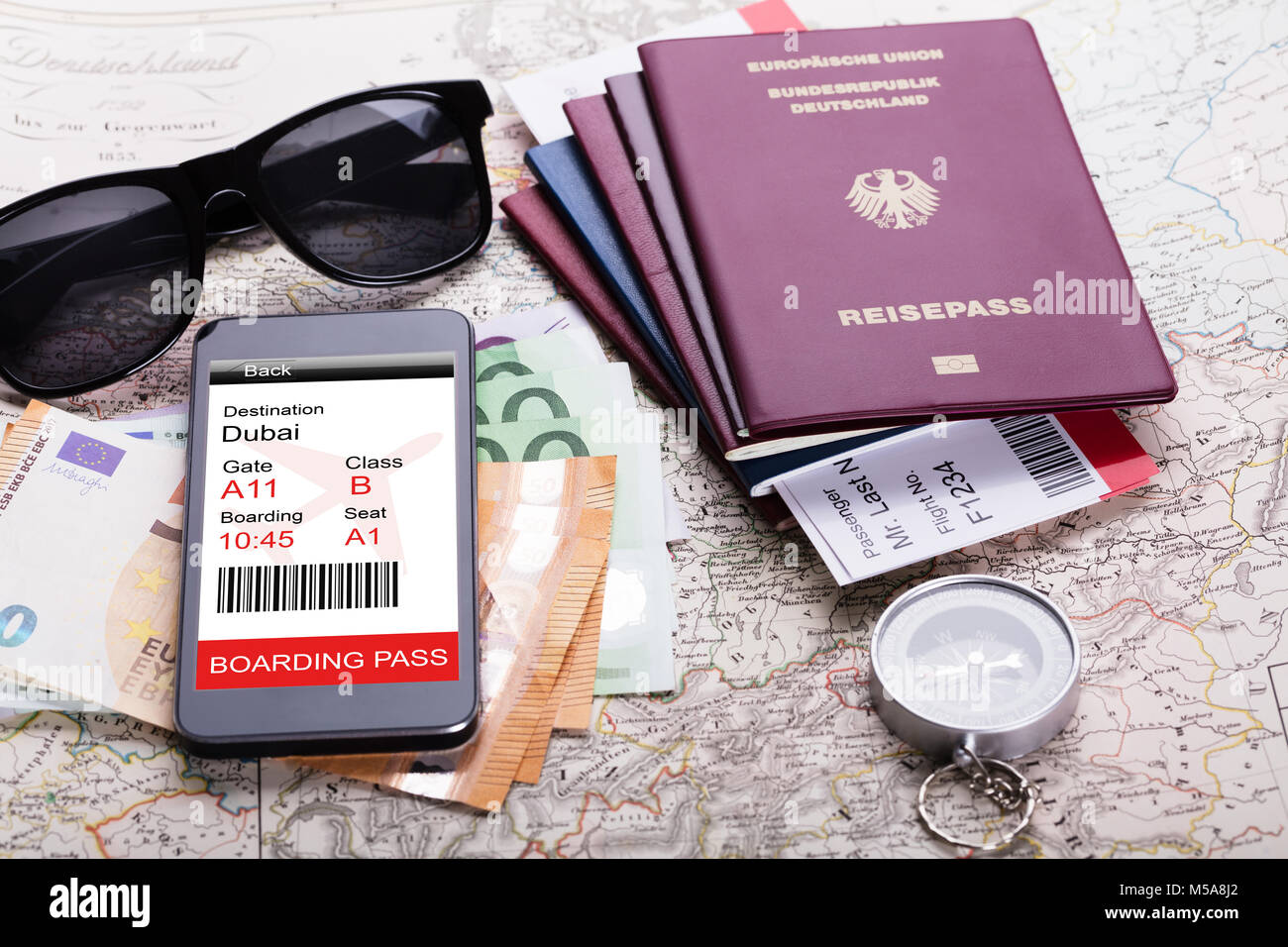 868732f481b Passport And Currency Notes With Smartphone Showing Electric Boarding Pass  On Map - Stock Image