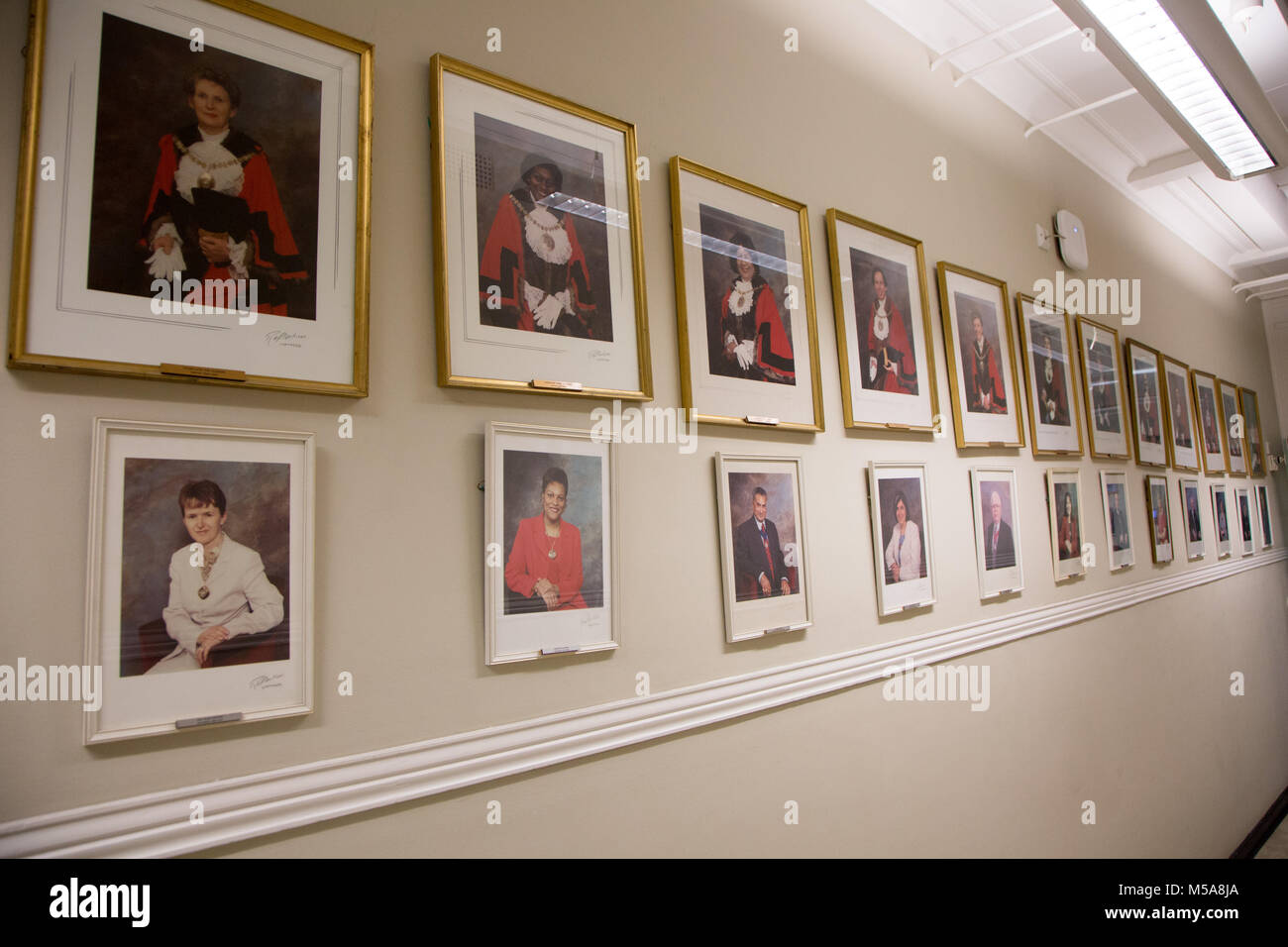A wall a Barnet Town Hall featuring framed photos of past Mayors - Stock Image