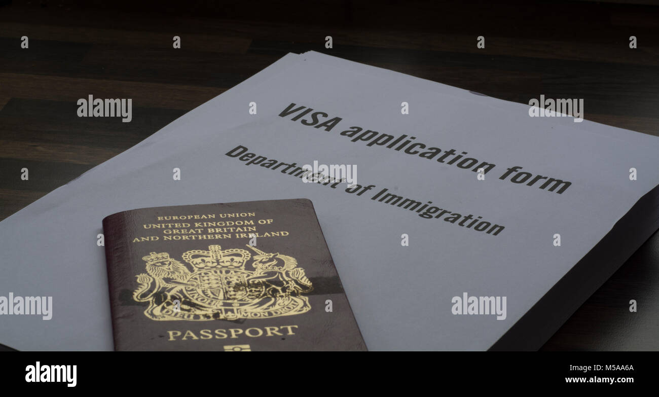 Passport application form stock photos passport application form a visa application form with a british passport on top of it applying for a falaconquin