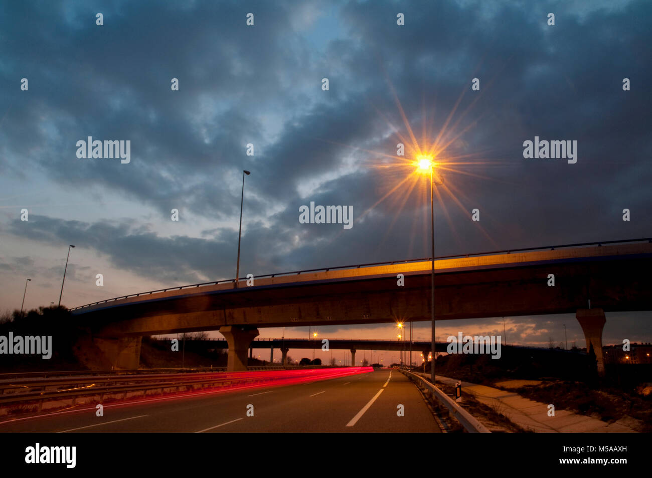 Bridge over highway, night view. Madrid, Spain. Stock Photo