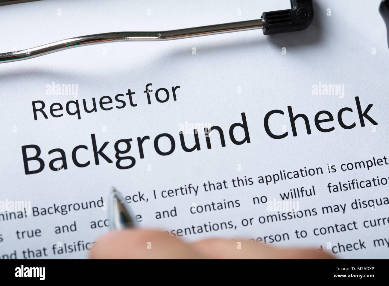 High Angel View Of Criminal Background Check Application Form With Pen - Stock Image