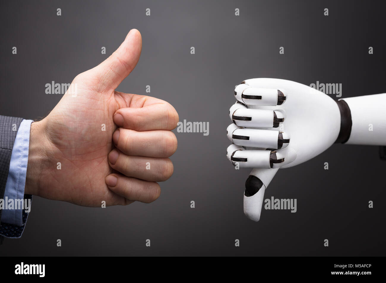 Businessperson And Robot Showing Thumb Up And Thumb Down Sign On Grey Background - Stock Image