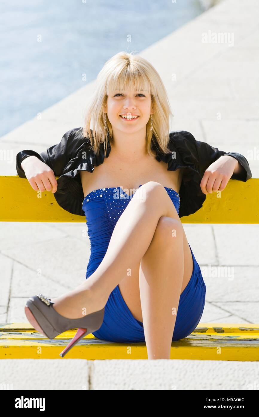 Legs play stiletto high-heels shoes blonde hair happy spike spiked model-released release - Stock Image