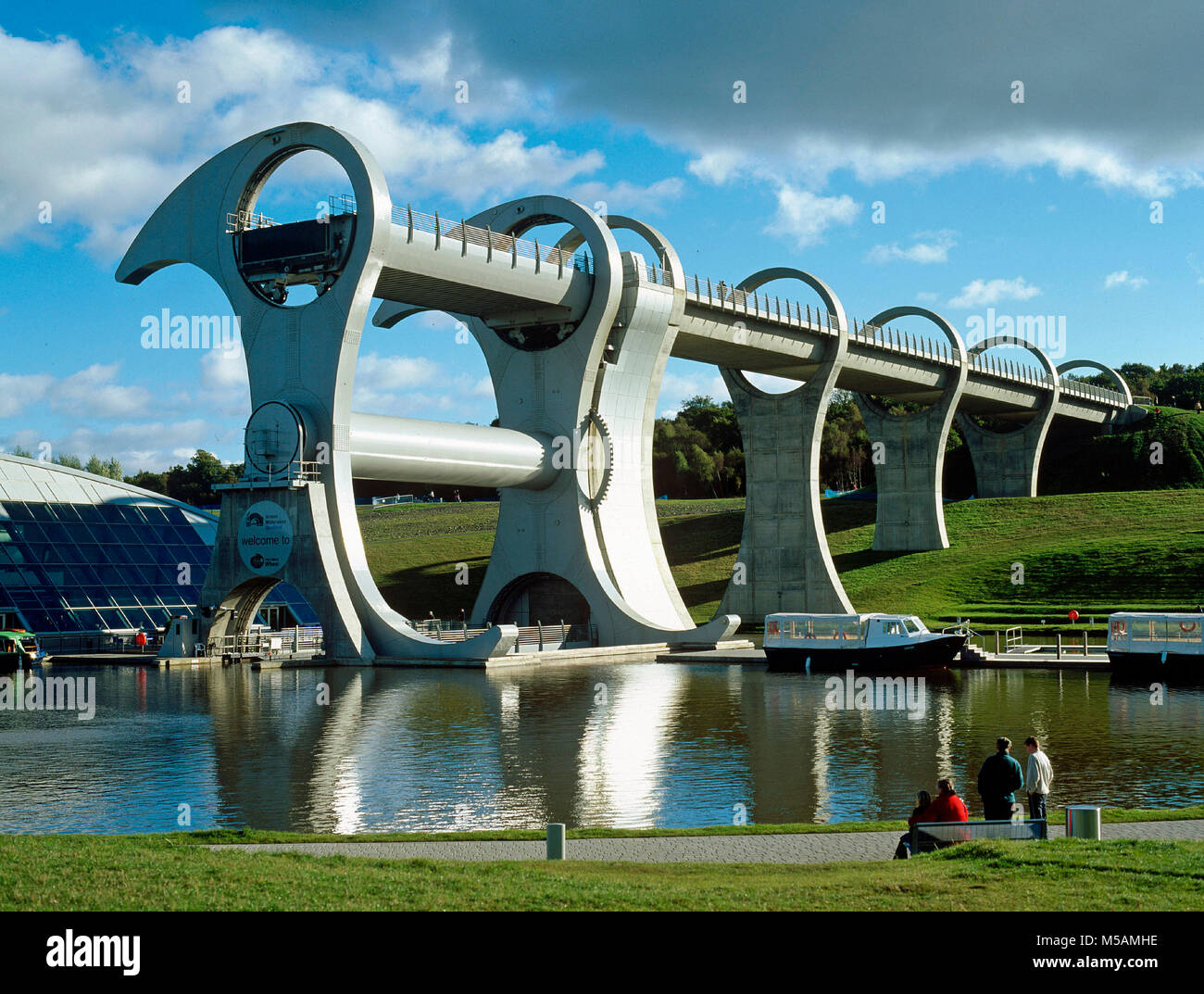 Falkirk Wheel, a rotating boat lift opened in 2002 to connect the Forth and Clyde Canal with the Union Canal 79ft - Stock Image