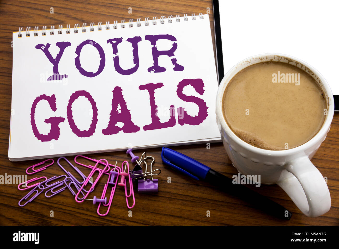 Hand writing text caption inspiration showing Your Golas. Business concept for Goal Achievement written on note Stock Photo