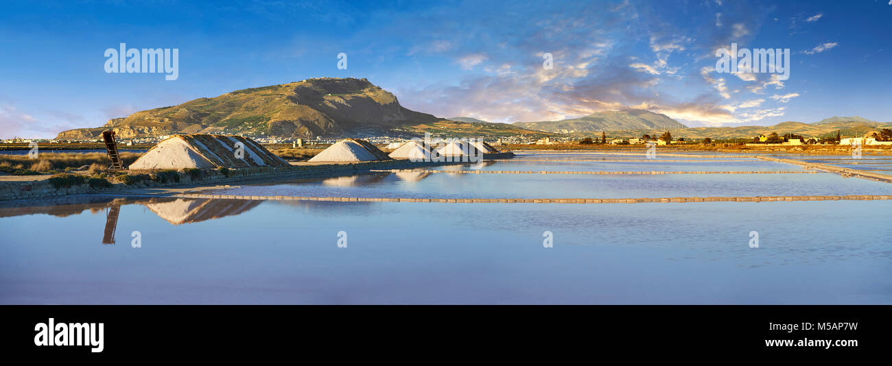Pictures & images of Pile of sea salt on the edge of the salt pans of the World Wildlife reserve of Saline di - Stock Image