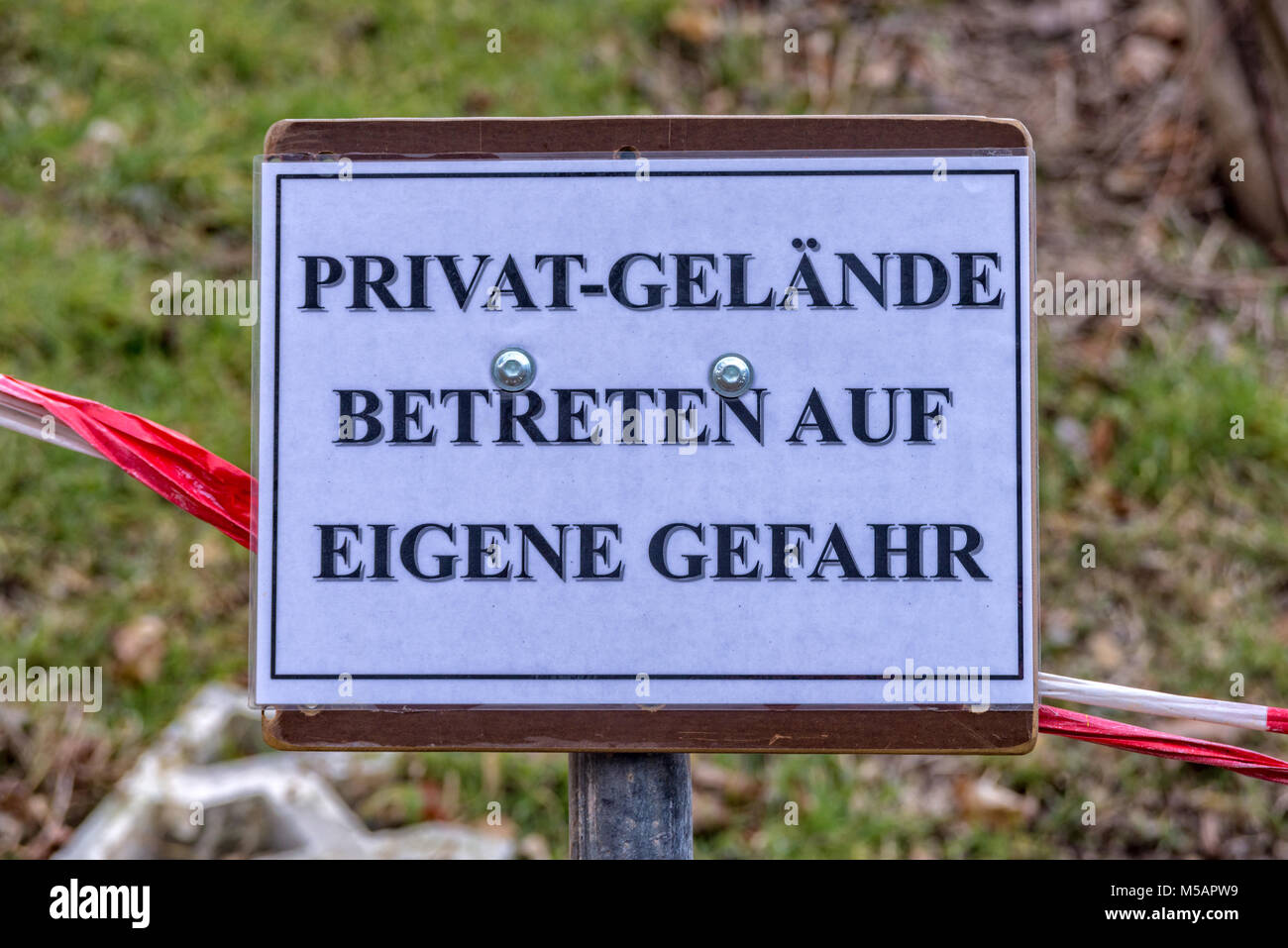 Private grounds enter at your own risk Stock Photo