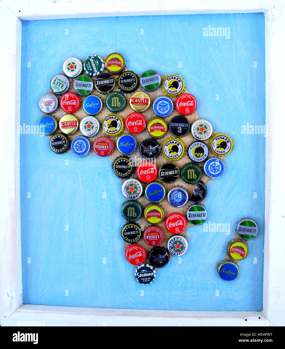 Colourful map of Africa made out of bottle tops, set in a white frame, made in Tanzania - Stock Image