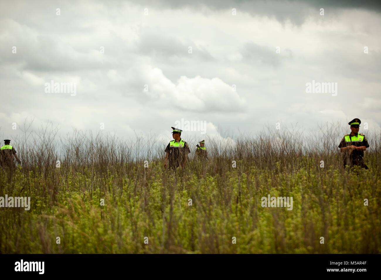 Police guard a small farm house that was used by Joaquin 'El Chapo' Guzman to escape Altiplano prison near - Stock Image