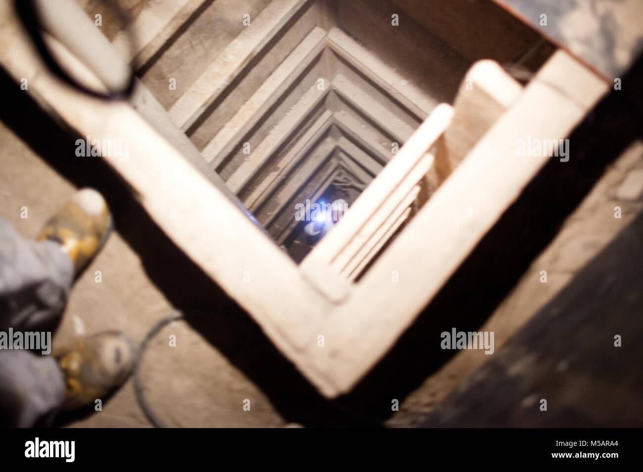 An investigator in the farm house tunnel used by Joaquin 'El Chapo' Guzman to escape Altiplano prison near - Stock Image