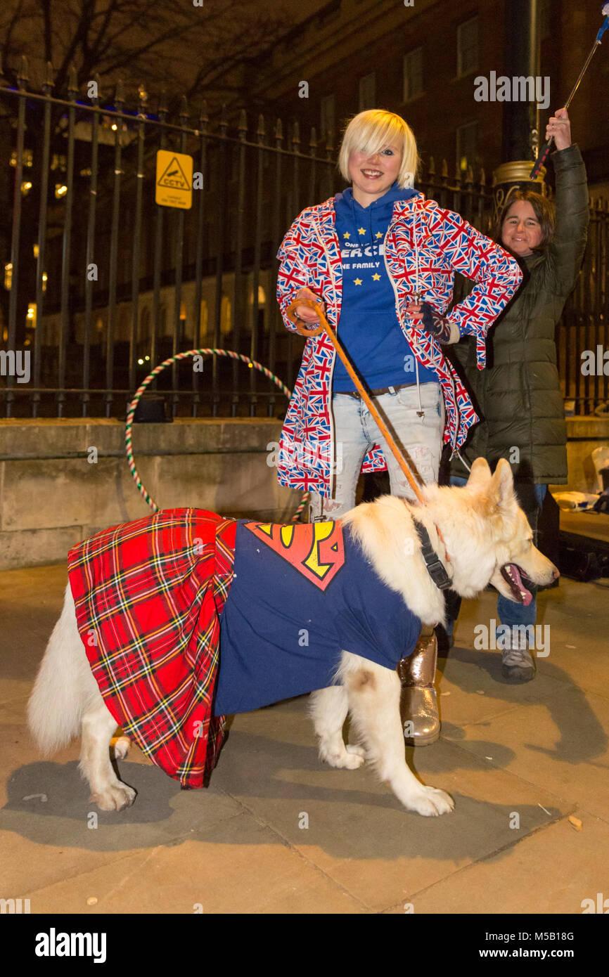 Whitehall, London, 21st Feb 2018.  'EU Super-Girl' Madeleina Kay with Alba, the 'Brexit White Superwolf' - Stock Image