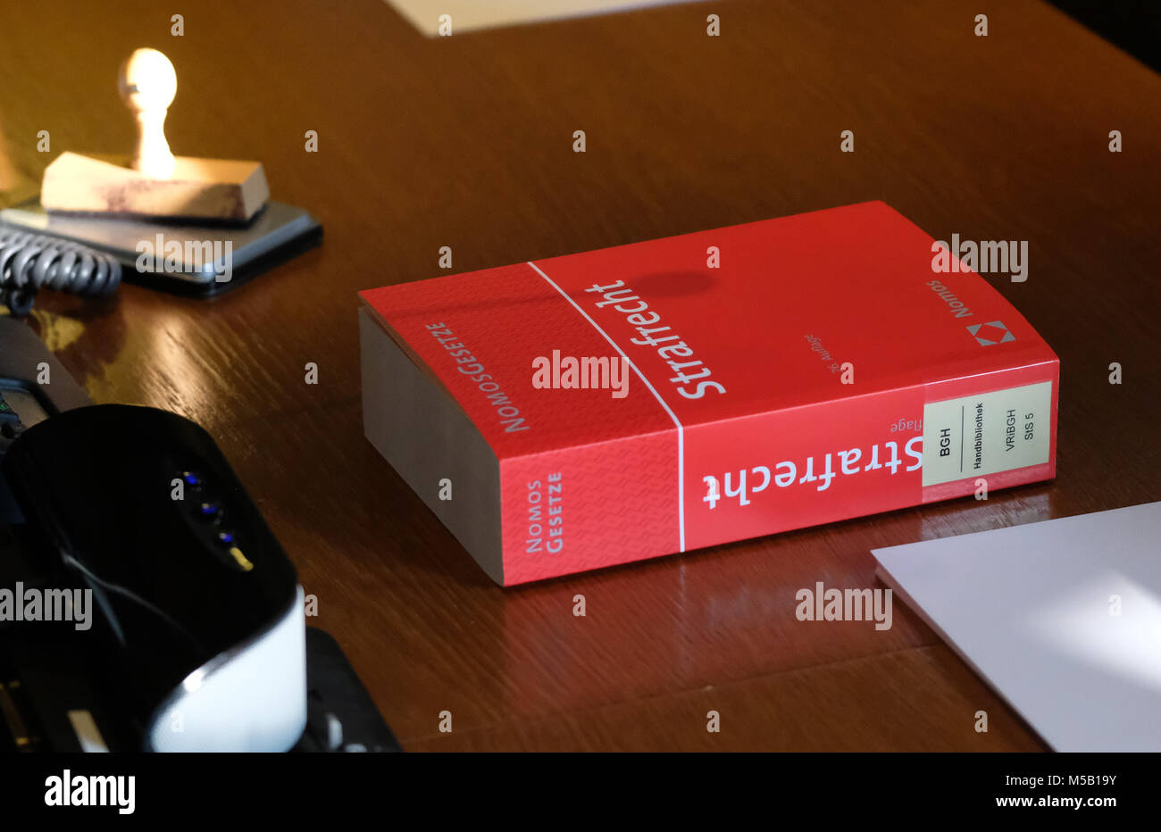 21 February 2018, Germany, Leipzig: A German Civil Code lies on the judges' table in a court room of the state - Stock Image