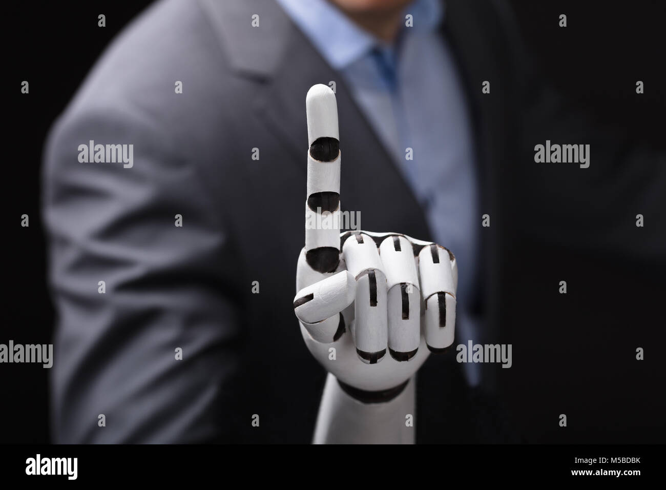 Close-up Of A Businessperson With Robotic Arm Touching Screen - Stock Image