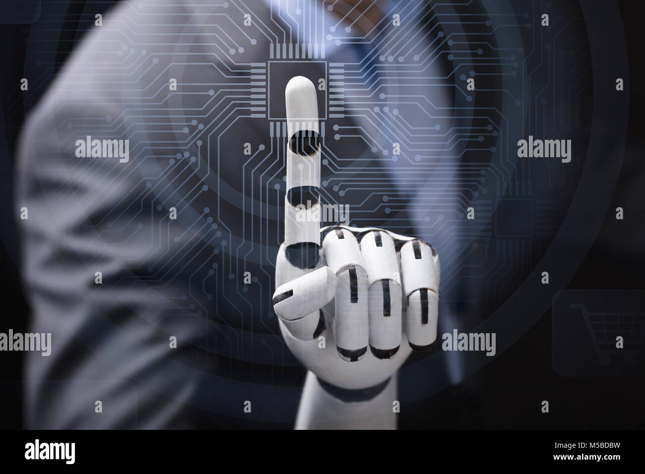 Close-up Of A Businessperson With Robotic Arm Touching Abstract Transparent Computer Micro Chip - Stock Image