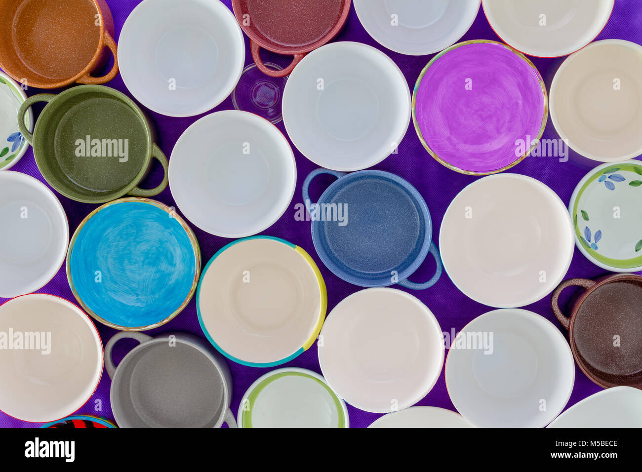 Overhead view of tightly packed assorted empty clean cups in a concept of hunger or thirst in a full frame background Stock Photo