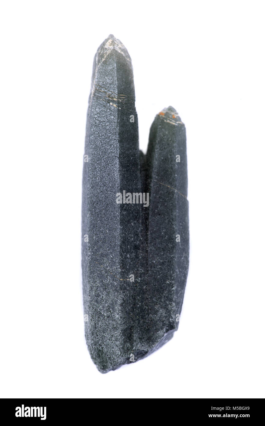 Natural green quartz point with actinolite  inclusions from Huanggang Mine, Chiefeng, Inner Mongolia, China - Stock Image