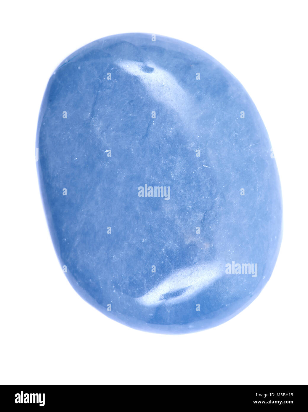 Polished angelite palm stone from Peru isolated on white background - Stock Image