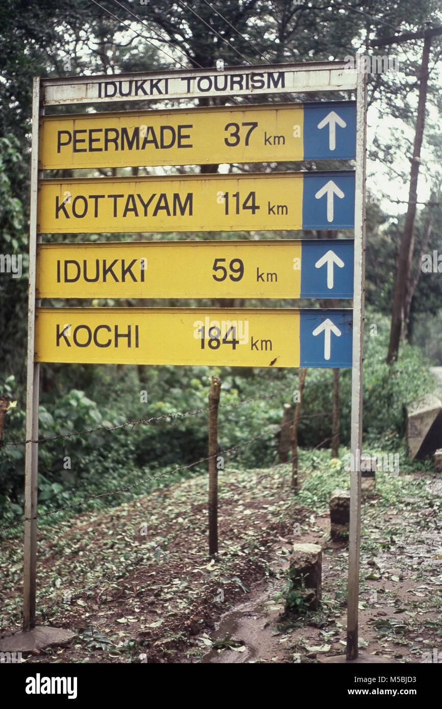 Road sign showing distances at Periyar, Kerala, India - Stock Image