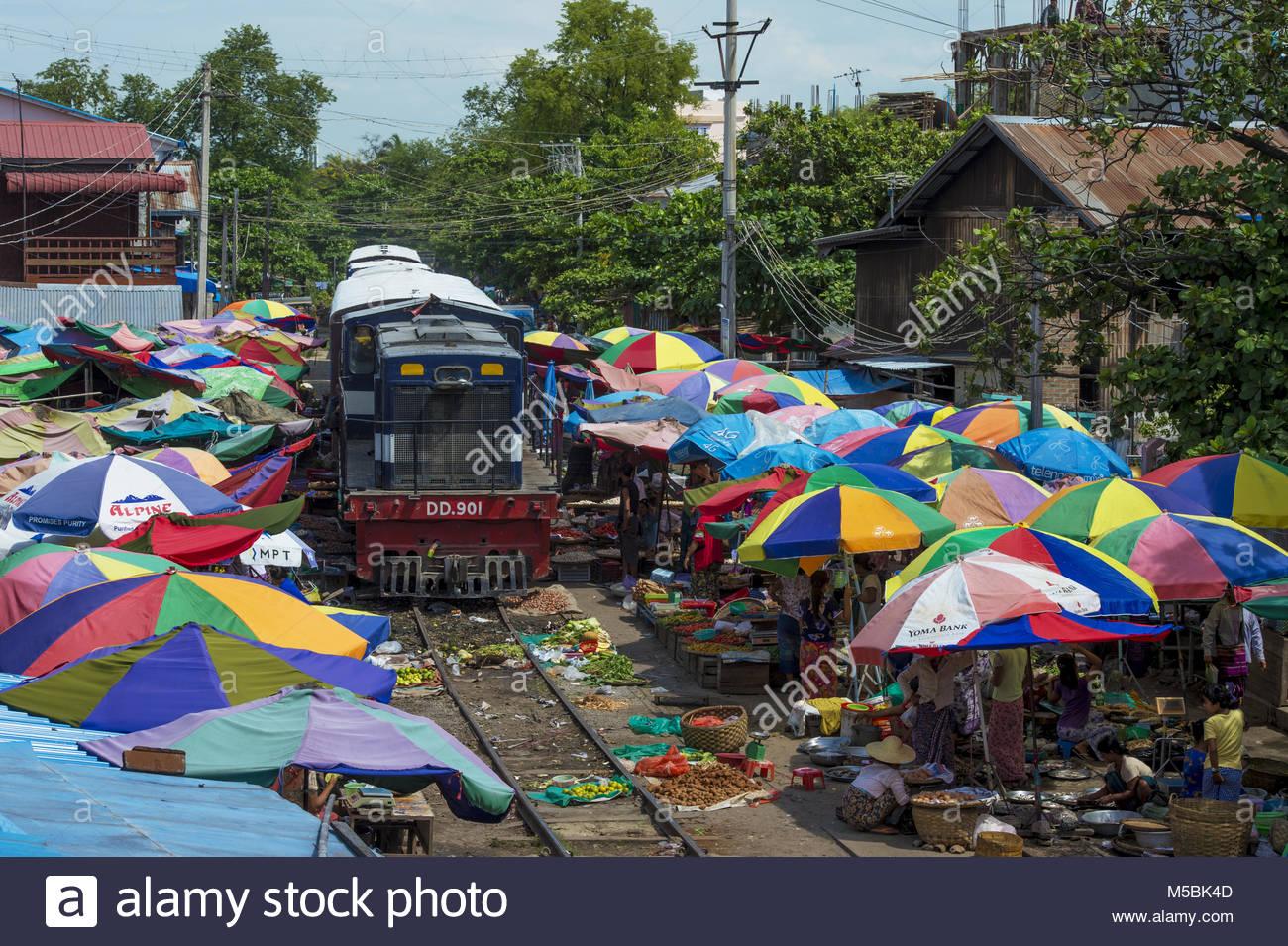 Myanmar, Mandalay, the Jaye Ze market takes place on the railroad Stock Photo