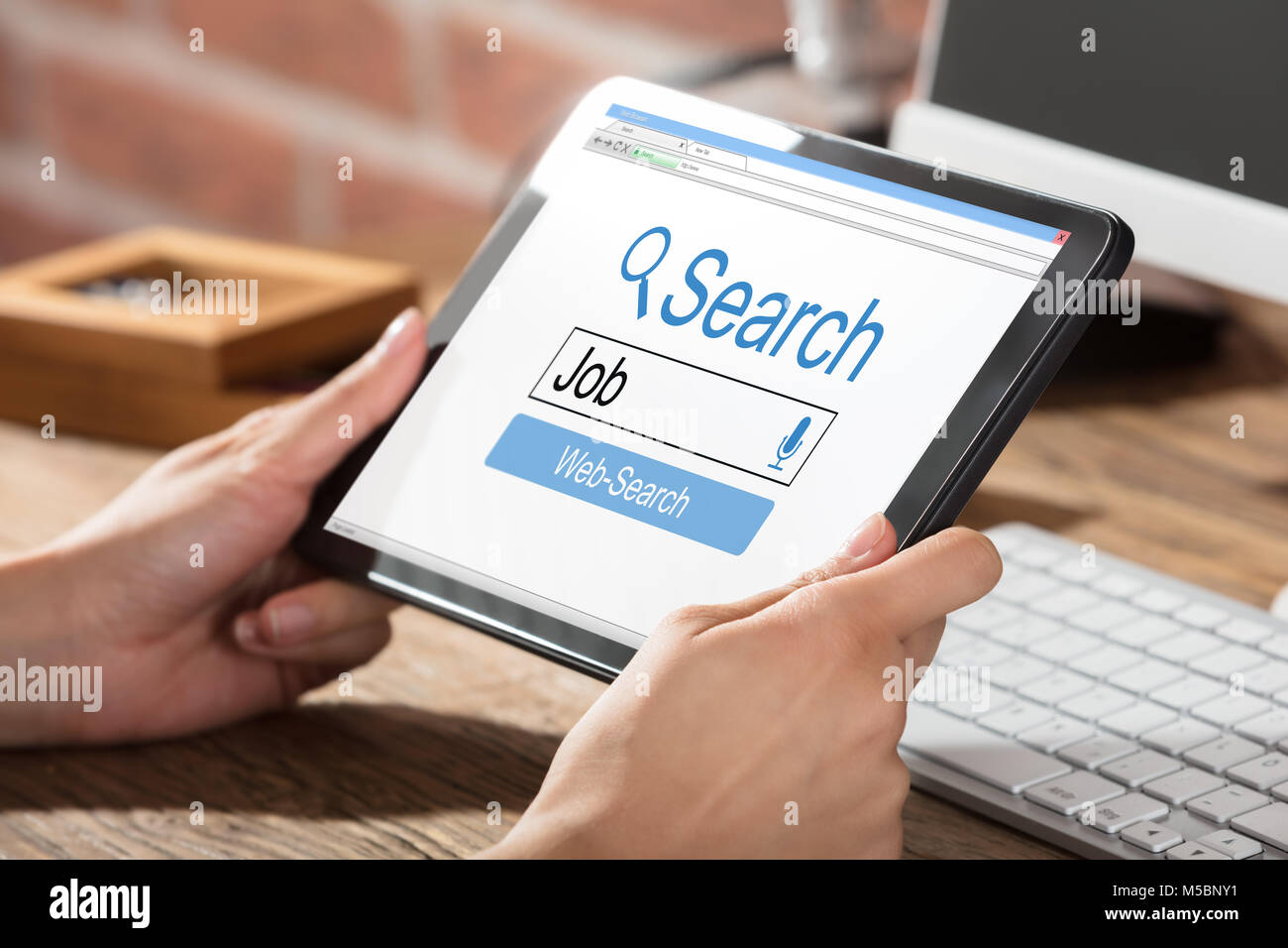 Person Searching Online Job On Digital Tablet - Stock Image