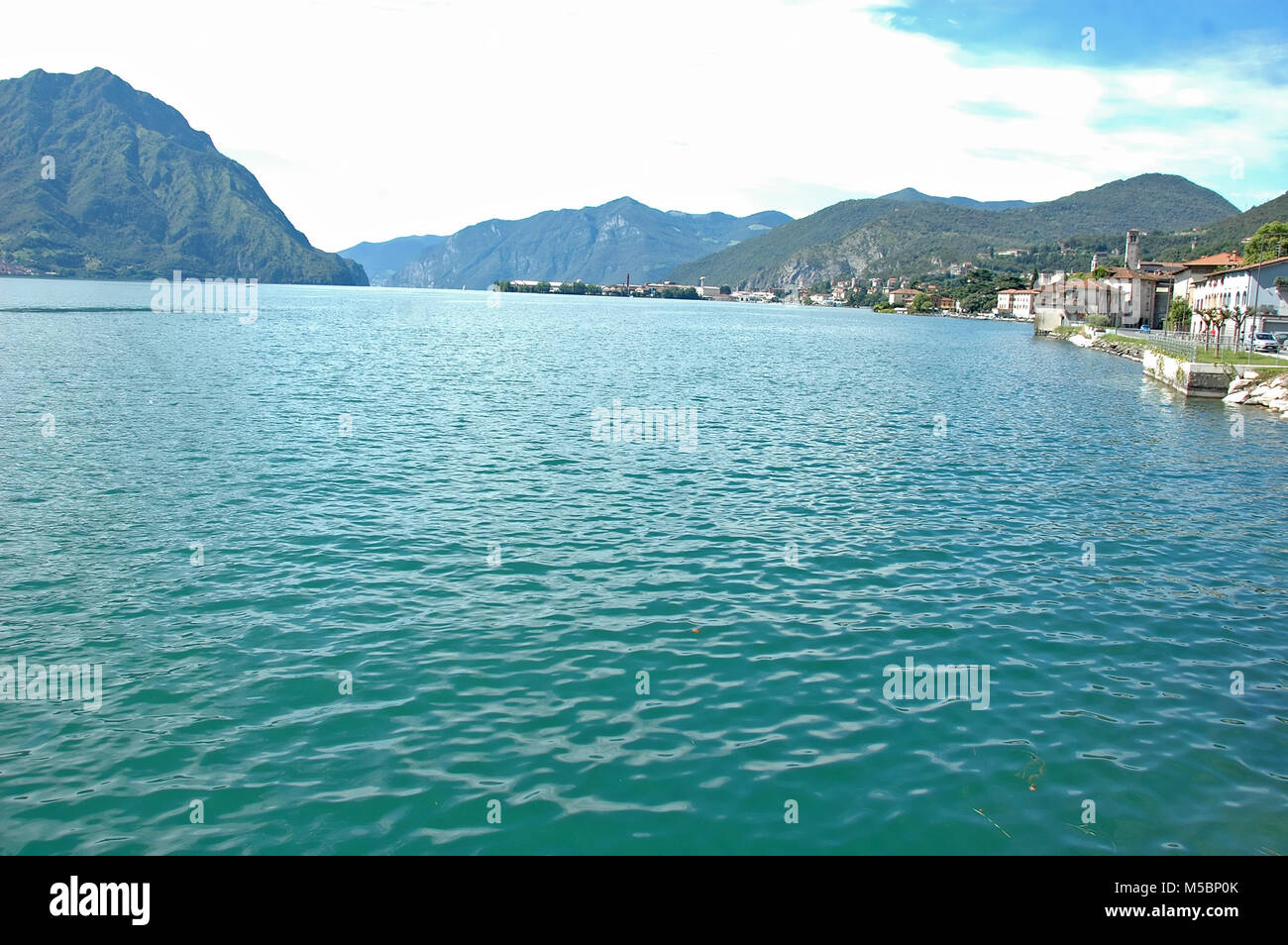 Darfo on the northern end of Lake Iseo in northern Italy, on a calm summer's day - Stock Image